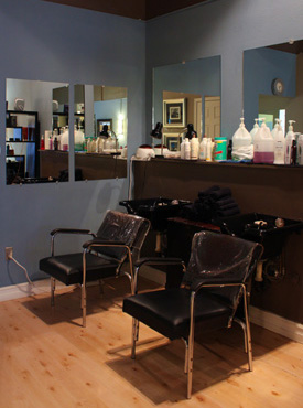 The Looking Glass Salon can do high lights, low lights, all over color and perms